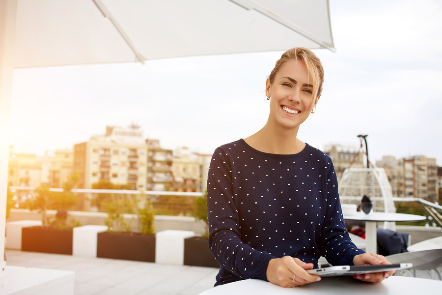 female business owner on rooftop with tablet