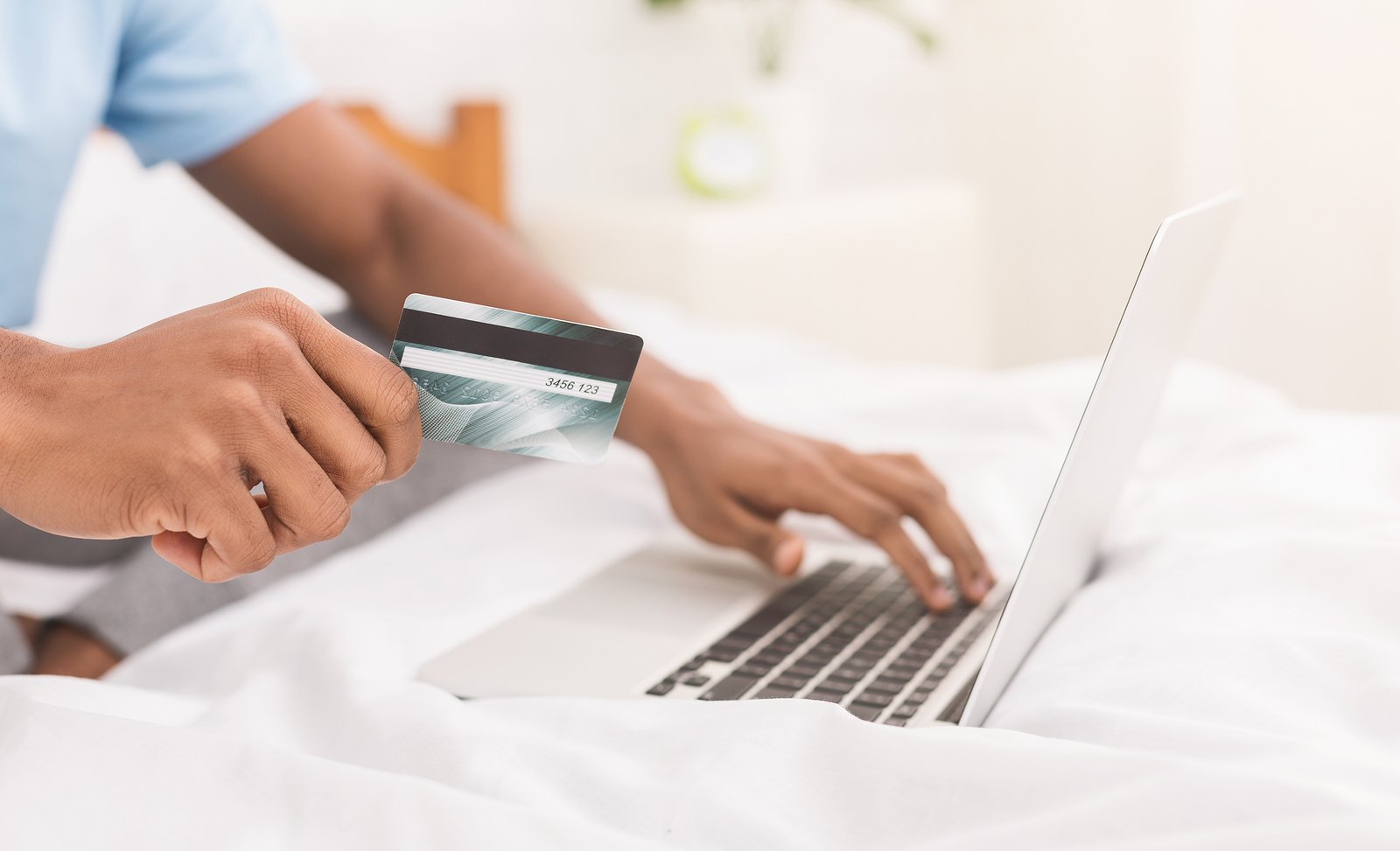 Online Shopping on laptop with credit card